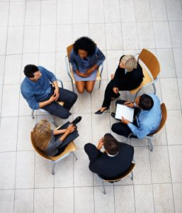 Top view of multi ethnic business people sitting in circle and discussing